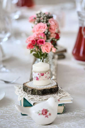Decoration of restaurant table in a wedding style photo