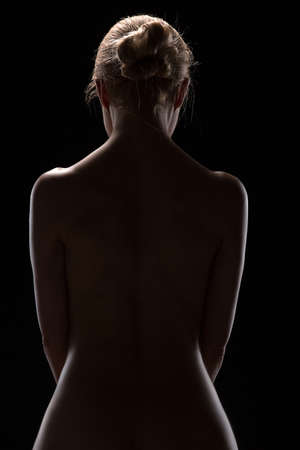 nude blonde: Art nude picture of naked blonde in the studio. The lighting in the style of low-key. Stock Photo