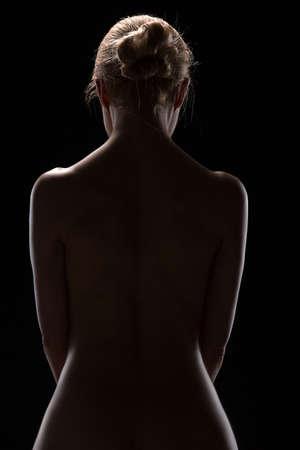 femme noire nue: Art photo nue de blonds nue dans le studio. L'�clairage dans le style de low-key.