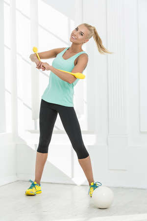mace: Rhythmic gymnast in the studio. With the mace and ball for gymnastics.