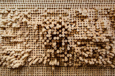 protruding: Rows of wooden rounded shanks that protruding at different lengths from the crowd and looks like a sound wave ostsilogrammy. Stock Photo