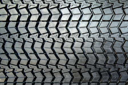 tread: Photo coarse textured black tire tread large truck close-up. Stock Photo