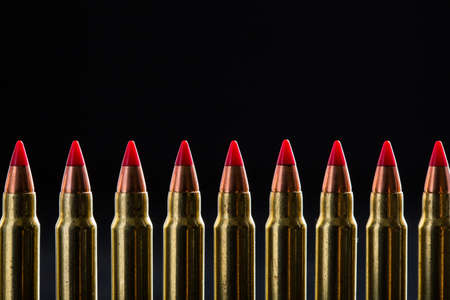 ranked: Top croped cartridges ranked with red tip on a black background