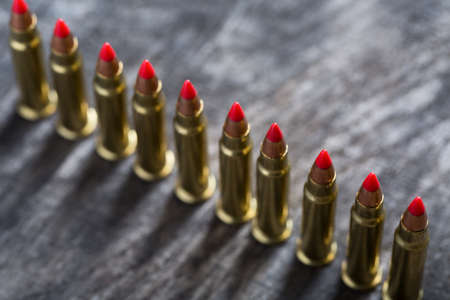 ranked: Cartridges ranked with red tip on a dark wooden background