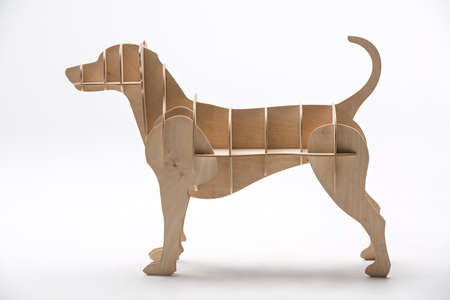 Wooden jack russell terrier's model made of plywood. It's stands sideways on a white background in the studio. Horizontal. Standard-Bild