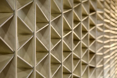 wooden partition: Ornamental light wooden partition. The ornament consists of triangles. Horizontal.