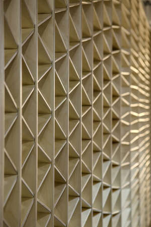 wooden partition: Ornamental light wooden partition. The ornament consists of triangles. Vertical.