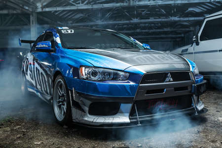 sportcar: Kiev, Ukraine - 14 May 2014: Mitsubishi Lancer Evolution X tuning sport-car. It colored in blue, gray, whites colors with patterns and prints. Editorial photo.