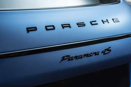 sportcar: Kiev, Ukraine - 14 May 2014: Porsche Panamera 4S tuning sport-car. It colored in blue matte color. Editorial photo. Closeup view of the back side. Editorial