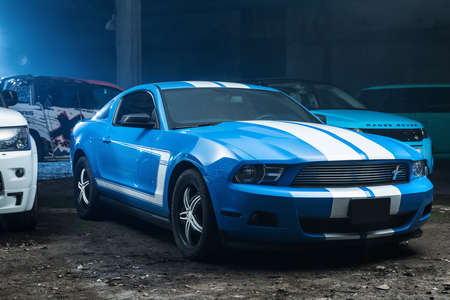 Kiev, Ukraine - 14 May 2014: Ford Mustang tuning sport-car. It colored in blue color with white stripes. Editorial photo. Editorial