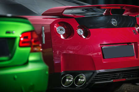 sportcar: Kiev, Ukraine - 14 May 2014: Nissan GT-R tuning sport-car. It colored in red and black colors. Editorial photo. Closeup back view.