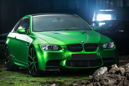 sportcar: Kiev, Ukraine - 14 May 2014: BMW M3 Coupe tuning sport-car. It colored in acid green color. Editorial photo.