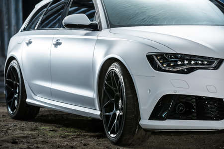 Kiev, Ukraine - 14 May 2014: Audi RS6 tuning sport-car. It colored in white color. Editorial photo. Closeup side view. Редакционное