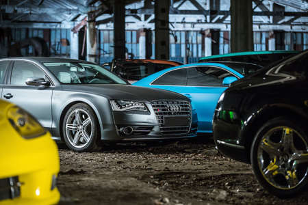 sportcar: Kiev, Ukraine - 14 May 2014: Audi S8 tuning sport-car on the background of other autos. It colored in gray color. Editorial photo. Editorial