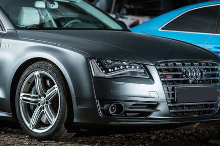 sportcar: Kiev, Ukraine - 14 May 2014: Audi S8 tuning sport-car. It colored in gray color. Editorial photo. Closeup front view. Editorial