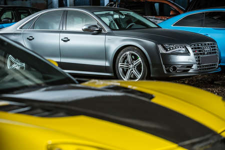Kiev, Ukraine - 14 May 2014: Audi S8 tuning sport-car surrounded by other autos. It colored in gray color. Editorial photo.