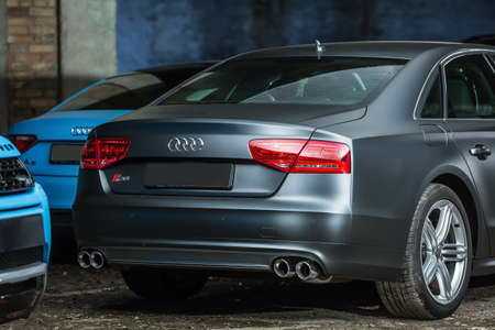 sportcar: Kiev, Ukraine - 14 May 2014: Audi S8 tuning sport-car. It colored in gray color. Editorial photo. Closeup back view. Editorial