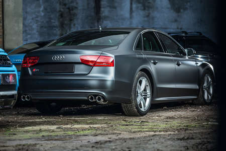 sportcar: Kiev, Ukraine - 14 May 2014: Audi S8 tuning sport-car. It colored in gray color. Editorial photo. Shoot from the back. Editorial