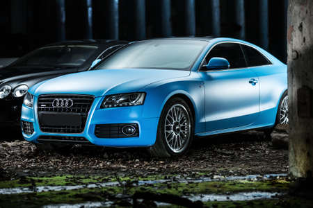 sportcar: Kiev, Ukraine - 14 May 2014: Audi S5 Coupe tuning sport-car. It colored in blue color. Editorial photo. Shoot from the side.
