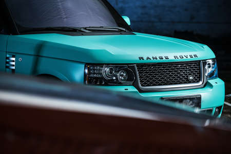 sportcar: Kiev, Ukraine - 14 May 2014: Range Rover Freelander tuning sport-car. It colored in turquoise color. Editorial photo. Closeup front view.