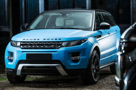 sportcar: Kiev, Ukraine - 14 May 2014: Range Rover EVOQUE tuning sport-car. It colored in cyan and black colors. Editorial photo.