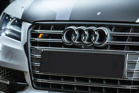 sportcar: Kiev, Ukraine - 14 May 2014: Audi S7 tuning sport-car. Audi colored in white, black, gray colors with patterns. Editorial photo. Closeup view of the car radiator grille.