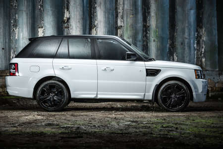 sportcar: Kiev, Ukraine - 14 May 2014: Range Rover Sport tuning sport-car. It colored in white color. Editorial photo. Shoot from the side.