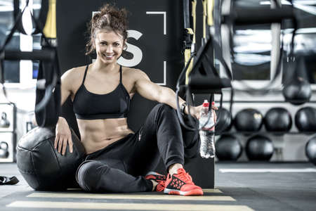Sportive woman in gym Stock Photo