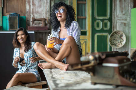 stool: Asian girls in bar Stock Photo