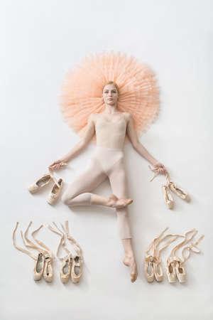 Blonde ballerina lies in studio