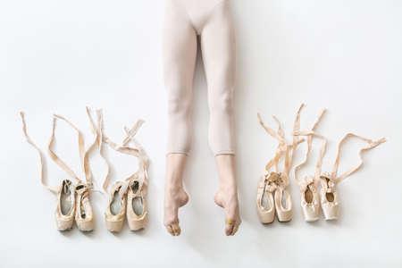Ballerina lies in studio Stock Photo