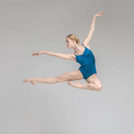 Ballerina posing in jump Stock Photo