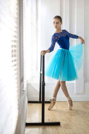jalousie: Ballerina is training on barre