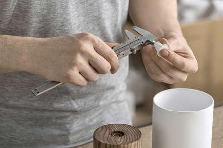 Man using caliper in workshop