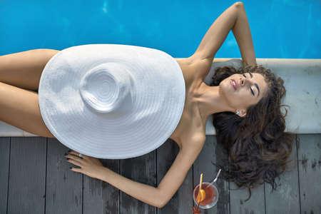 Model near swimming pool outdoors Stock Photo