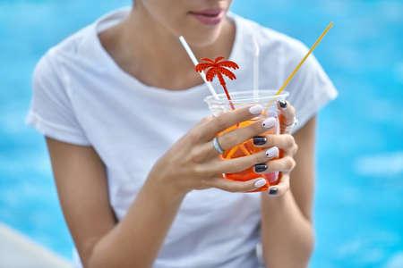 Model with orange cocktail Stock Photo