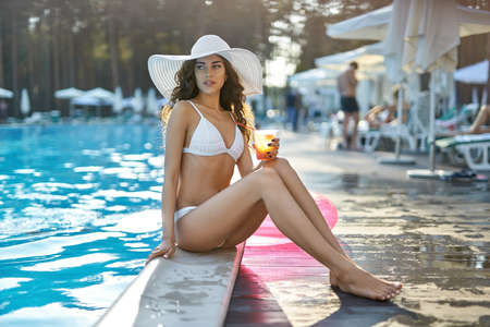 Model near swimming pool outdoors Stock Photo