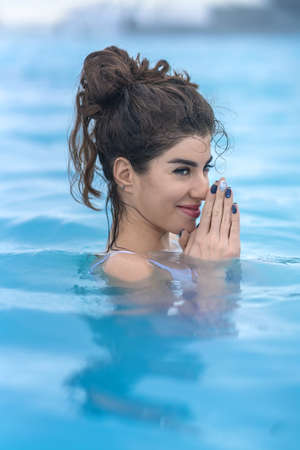 woman bath: Girl relaxing in geothermal pool outdoors Stock Photo