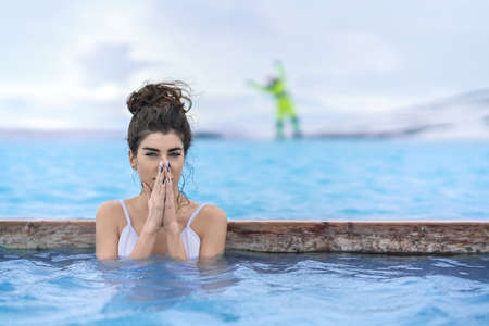 Girl relaxing in geothermal pool outdoors Stock Photo