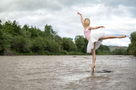 Ballerina posing in river