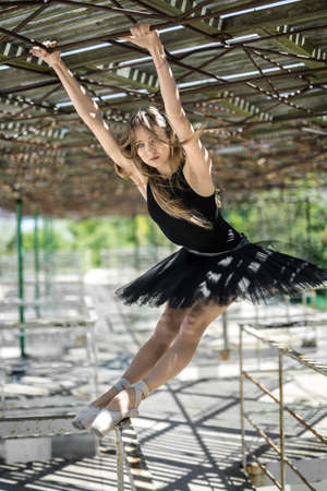 Ballerina posing outdoors Stock Photo