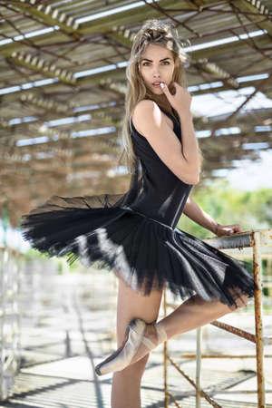 Ballerina posing outdoors Stock Photo
