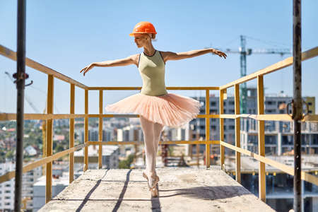 Ballerina posing at concrete balcony Stock Photo