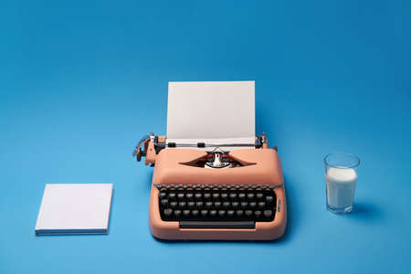 Composition with typewriter, book and glass, studio shoot. Фото со стока