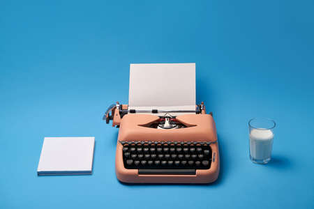 Composition with typewriter, book and glass. Studio shoot. Фото со стока