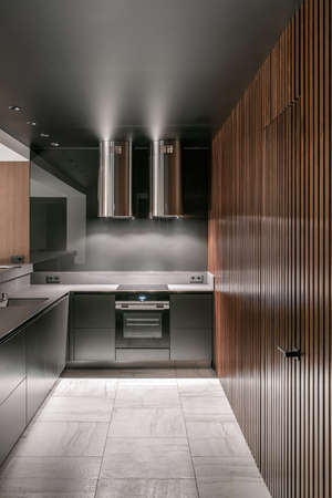 Luminous modern kitchen with glossy metallic surfaces