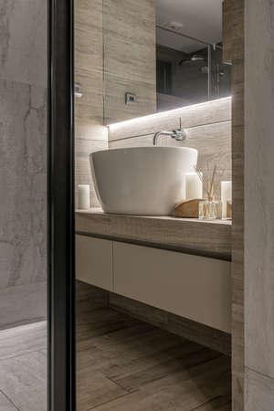 Luminous modern bathroom with textured tiled walls