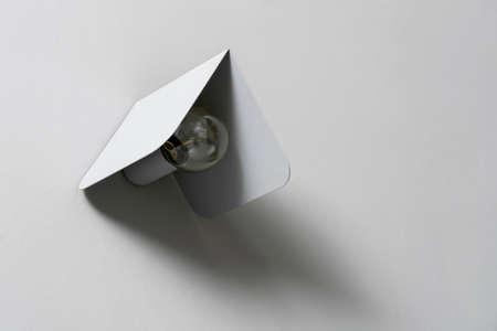 Fancy gray metal lamp on wall in studio