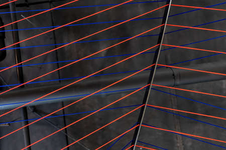 Multicolored ropes lines installation in illuminated interior