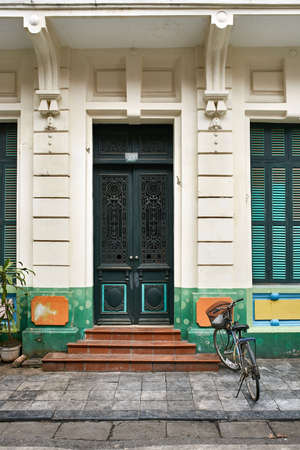 Colorful exterior of old house with vintage doors and windows